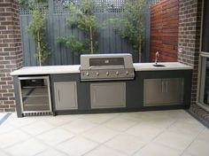 Rhiannon Gillett uploaded this image to 'garden insperations'. See the album on Photobucket. Modern Outdoor Kitchen, Outdoor Kitchen Cabinets, Backyard Kitchen, Backyard Bbq, Outdoor Kitchens, Outdoor Rooms, Outdoor Dining, Outdoor Patios, Parrilla Exterior