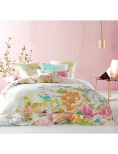 Bring the sunshine with this duvet cover set, which features soft washed golden marigolds, pretty peonies and delicate daisies in a balmy watercolour panel print of hand painted yellow and pinks on fresh white cotton sateen.