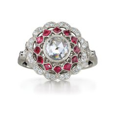 Ruby and diamond ring from the Kwiat Vintage Collection in platinum.    Layers of rubies and diamonds extended to a scalloped edge and surround a classic rose cut diamond center.