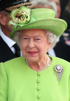Queen Elizabeth II watches a Ceremony to Commemorate D-Day 70 on Sword Beach on June 6, 2014 in Ouistreham, France.