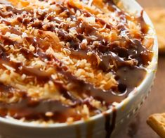 Samoa Dip... Inspired by the favorite girl scout cookie, this dip is packed with caramel, coconut, chocolate goodness and made into one creamy, addicting and delicious appetizer!