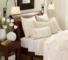 Love the neutral bedding and accessories with the dark wood!  Valencia Sleigh Bed & Dresser Set #potterybarn