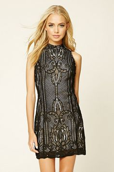 A sleeveless mini dress featuring an allover crochet design, bodycon silhouette, mock neck, a scalloped hem, and a concealed back zipper.