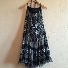 Anna Sui for Anthropologie halter dress Black and Cream Anna Sui for Anthropologie lined halter dress. Like New. Shell is 100% silk, lining is 100% acetate. Anthropologie Dresses Midi