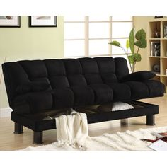 @Overstock - Accommodate overnight guests with this black microfiber futon sofa bed. The contemporary style futon is constructed of solid wood and metal, with a plush microfiber futon that has an elephant skin texture.  Two plush pillows are included.http://www.overstock.com/Home-Garden/Black-Elephant-Skin-Microfiber-Futon-Sofabed-with-Storage/6626839/product.html?CID=214117 $567.99