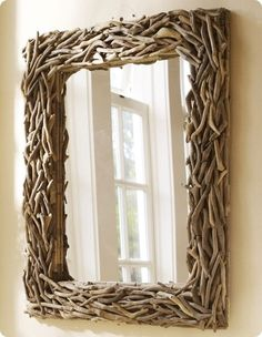 another nice mirror idea, that is if all your drift wood is of equal size. It does look nice though, and it's functional.