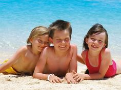 Photo about Three children laying in the sand at the water s edge on a tropical island beach. Image of enjoy, nature, colors - 2614760 Bff, Images Of Colours, Poses, Vitamin D, Island Beach, Technology Logo, Three Kids, Happy Kids, Beach Photos
