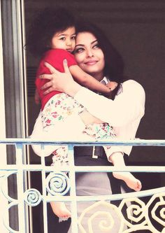 Super-mom Aishwarya Rai and her cute little princess Aaradhya pose for the camera from their hotel balcony at the Cannes International Film Festival
