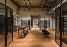 A continuous clothing rail runs through Comme Moi's first flagship store in…