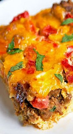 This Taco Breakfast Casserole is SO good. Taco meat, eggs, milk, cheese, bread and rotel tomatoes.