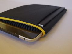 mattt - iPad & sketchbook sleeve - grey and black striped lining with a bright yellow zipper. $50.00, via Etsy.