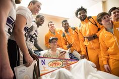 Members of the Northwestern Wildcats and Tennessee Volunteers football teams visited patients at TGH on Monday in advance of the Outback Bowl game.