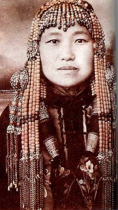 Old photo showing female wearing similar earrings from Jungar Banner , Ordos Mongolia, early 20th c (page 28 Folk Customs of the Ordos Mongolian People)