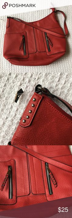 """Brand New Red Studded Shoulder Bag Brand: Attention  Condition: New with attached tag (although most of the tag has been cut off, it's still there)  Measurements: 15"""" wide x 10"""" tall (middle portion), 12"""" tall on sides, 4"""" deep and 13"""" strap drop.   I will not model, please pay attention to measurements. This is a medium/large size bag and fits perfectly under the arm. Not a crossbody.   Hardware is silver-toned. Smoke-free home. Has zippered section inside and two slip pockets inside…"""