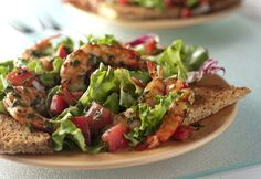 Shrimp, garlic, chopped herbsand diced tomato are tossed with a balsamic vinaigretteto make a sophisticated topper for salad greens.