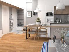 Projekt apartamentu na warszawskim Powiślu.  Nowoczesna kuchnia w stylu minimalistycznym. W wystroju wnętrz przeważa kolor biały, z którym kontrastujądodatki w kolorze naturalnego drewna.  Progetti Architektura