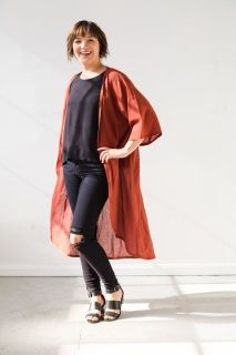 """Long, lightweight and a definite showstopper.  Made out of 100% cotton lawn with wide, mid-length sleeves.  The long length finishes mid-calf with a rounded hem.  Wear it over the Sara Box Top and a pair of skinny jeans or paired with the Olivia Dress for a comfortable, effortless look.  A limited edition of 5.  FIT This garment is one size fits most and is intended to have a roomy, oversized fit.  47"""" long 27"""" across back 15"""" sleeve (taken from shoulder seam)  CARE Machine wash cold Tumble…"""