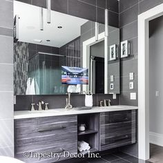 Inspiration for upcoming projects from my past #projectstreambank home! This master bath has a clean and modern look with gorgeous custom cabinets and this custom mirror with tv inset for a bit of luxury living! #tapestrydecor #design #decor #details #masterbath #bathroom #inspiration #custombuild #renovations #renovate