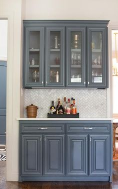Beautiful Butleru0027s Pantry Features Gray Blue Cabinets With Raised Panel  Cabinet Doors Paired With White Quartz Countertops And A Marble Chevron  Tiled ...