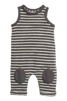 Cotton romper suit: BABY EXCLUSIVE/CONSCIOUS. Sleeveless romper suit in striped jersey made from organic cotton with press-studs on one shoulder and at the crotch, knee patches in a contrasting colour and sewn-in turn-ups at the hems.