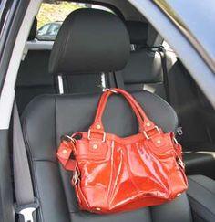 Clipa Securing Orange Purse to Car Headrest