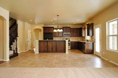 MOVE IN READY new home in Yukon, Oklahoma.  Valdera. Glenbrook floor plan. Open kitchen. Granite countertops. Custom cabinetry. Breakfast bar. Walk-in pantry. Window in kitchen. Kitchen island. Island in kitchen. Tile floors. Drawers. Cabinets. http://4cornershomes.com/c_movein_details.php?item=15&home=174