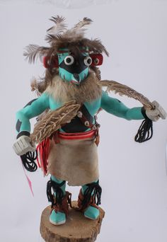 """Lot 70 in the 6.3.14 online & live auction! Extraordinary signed wooden Southwest style """"Blue Ahote"""" Kachina doll by artist D. Largo. A wonderful example of a traditional Native American Indian art form. This Kachina or Katsina (in native tongue) features a carved cottonwood body with hand painted details in vibrant colors, finely crafted facial features with """"pop-eyes"""", dressed in a traditional regalia / costume adorned w/ feathers, fur & leather. Signed on the bottom. #Decor #Home…"""