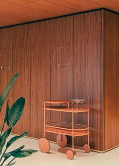 Stockholm-based Note Design Studio has renovated a 1950s restaurant in Helsinki, using a teak-lined scheme that honours the building's modernist design.