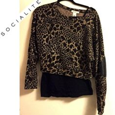"SALE Socialite leopard sweater with elbow patches! ✨LOVING the elbow patches! Sassy, cozy, and cool✨ 🔹Brand: Socialite  🔹Size: M 🔹Colors: Classic leopard print 🔹Oversized crop style, doleman sleeves 🔹Length: about 19"", patch 5.5""L, hem band 17""W. Stetches  🔷Faux perf leather elbow patches 🔹Hand wash cold 🔹Fabric: 95%Poly/5% Spandex 🔹Condition: Excellent  🎀Feel free to ask, offer, bundle! Socialite Sweaters"