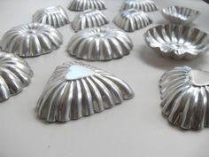 Vintage Set of 12 Biscuit Jello Molds by InsOddsOuts on Etsy, $9.99