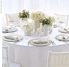 Cloud + Cream + PlatinumCuddle up with a cozy wrapped-in-cable-knit theme. Mosaic Shell aluminum chargers, platinum rim glassware, Lexington flatware, ivory linens, and silver reception chairs from Party Rental Ltd.     Event Design by Barb Salzman of Hat...