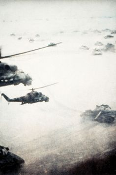 Soviet helicopters fly over their armour in Afghanistan.