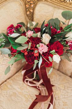 red and pink bouquet - photo by Amilia Photography http://ruffledblog.com/valentines-day-romance-inspiration