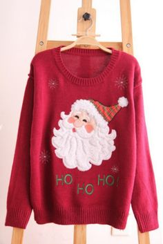Tis the season! This cute knit Santa sweater will be sure to keep you warm just in time for the holidays! Exclusive Wild Daisy design. Imported.