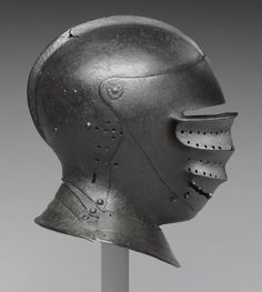 Close Helmet  Artist/maker unknown, Italian  Geography: Made in Italy, Europe Date: c. 1510 Medium: Steel (now oxidized to a deep russet color) Dimensions: 11 1/8 x 9 7/16 x 7 7/8 inches, 5 pounds 7.8 ounces (28.3 x 24 x 20 cm, 2.49 kg) Curatorial Department: European Decorative Arts and Sculpture