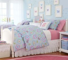 Could DIY the butterfly art on the wall with scrapbooking paper for her wall behind her bedroom door