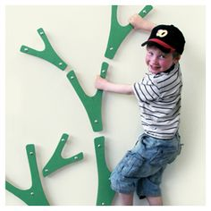 A climbing tree in your room: You can arrange these little pieces in whichever way you want to create a wall tree.  A little boys dream.