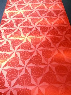 Vintage Japanese Kimono Silk Fabric - Glossy Orange/Red ombre - stars with optical illusion, via Etsy.