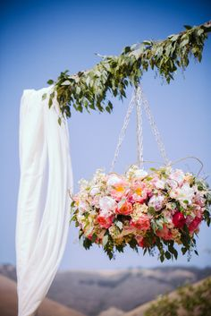 Gorgeous idea for the next garden party! Love this floral chandelier.