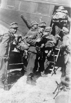 German paratroops of 5 Gebirgs-Division boarding a Junkers 52 at a Greek airfield, before flying to Crete, 20 May 1941. On that morning 3000 German paratroops landed at Maleme, Rethymno, Chania and Heraklion.