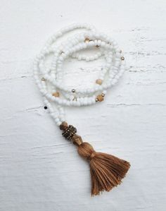 brown tassel, white beads mala