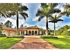 """4657 Idylwood Ln, Naples, FL 34119 — Best value in Quail West!  Offering the """"Bella Vita"""" breathtaking golf course and sunset views.  Mediterranean flare with pillared columns, large tile, dual gas fireplace accented in warm tones.  Situated on the 8th fairway of the Preserve Course.  Features include tray ceilings with coffer, double crown moldings, hardwood & marble floors an impressive pillared foyer. A gracious living room with fireplace & beveled picture window adjoining dining…"""