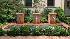 After passing through the courtyard doors, you are welcomed by dual fountain features that frame the walkway and provide a tranquil feeling upon entry into this private space.  Finding the right glass waterline tile for fountain and spa was difficult since we wanted it to be complementary to the antique brick and terra cotta paving colors, but the Bamboo Blend (Weave Series from Walker Zanger) provide the right balance of color, while also providing enough of a highlight.