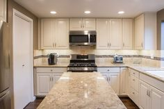 Nevern Cambria Countertops - this will be my.new countertops. Love the cabinet design and backsplash too. Kitchen Pantry, Kitchen And Bath, Kitchen Cabinets, Glass Kitchen Tables, Kitchen Decor, Kitchen Ideas, Kitchen Tips, Grey Kitchens, Cool Kitchens
