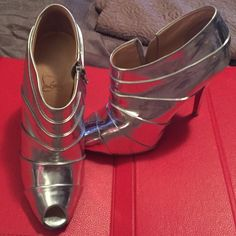 Christian Louboutin silver booties These fierce silver cbl peep-toe shoes are amazing!! Slay! 💕❤️ Christian Louboutin Shoes