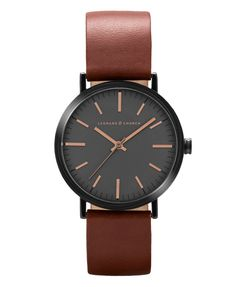 Two toned case minimalist watch with brown coffee leather strap with Swiss movement in a polished 2-toned 40mm case and made with sapphire crystal. Encased in surgical grade stainless steel. Paired with smooth, genuine natural leather straps that soften naturally with wear, padded and shaped from premium South American hides.