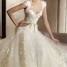 Love the lace bodice and sweetheart neckline on this wedding gown, cap sleeves, modest wedding dress, bridal gown with lace and satin bow