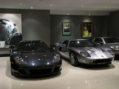 Gray walls with auto art.