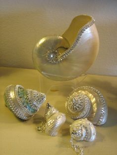 I would use them in a table scape for a destination wedding reception.. would include lots of candles.. including floating candles. 5 JEWELED SEA SHELLS Swarovski crystals. #destinationwedding