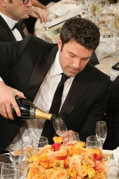 Ben Affleck poured himself some Champagne at the Golden Globes